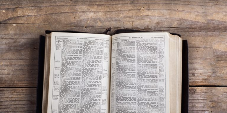 bible open on wooden table