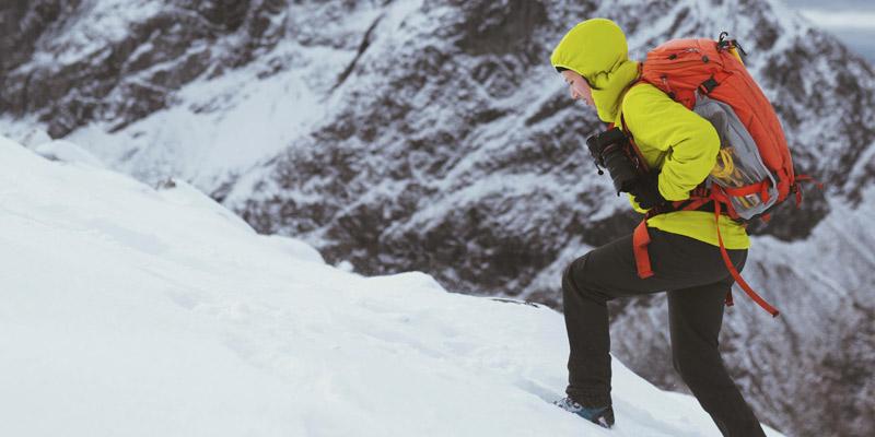Person climbing mountain illustrating application