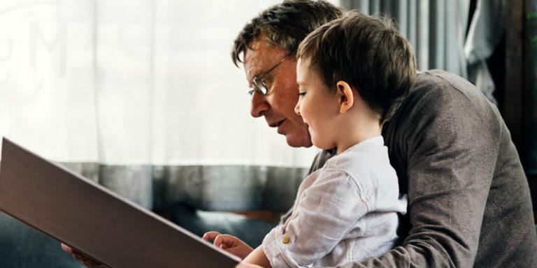 Grandfather explaining to Grandson