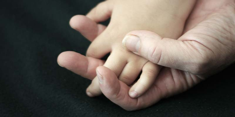 childs hand in fathers hand