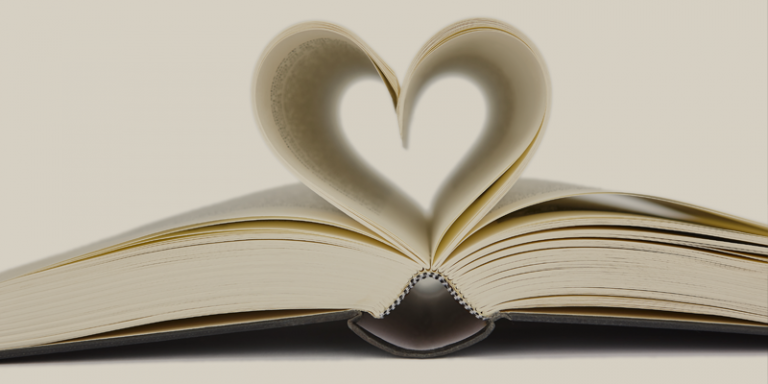 open book with heart shape made by pages illustrating 'the heart of the text'